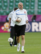Czech head coach Michal Bilek runs during the official training session on the eve of the Euro 2012 soccer championship Group A match between Greece and Czech Republic in Wroclaw, Poland, Monday, June 11, 2012. (AP Photo/Antonio Calanni)