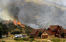 Poudre Fire Authority crews battle a wildfire in a mountainous area about 15 miles west of Fort Collins, Colo., on Sunday, June 10, 2012. Firefighters on Sunday were fighting wildfires that have spread quickly in parched forests in Colorado and New Mexico, forcing hundreds of people from their homes and the evacuation of wolves from a sanctuary. The Colorado fire grew to 22 square miles within about a day of being reported and has destroyed or damaged 18 structures. (AP Photo/The Denver Post, Helen H. Richardson) MAGS OUT; TV OUT; INTERNET OUT; MANDATORY CREDIT