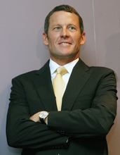 In this Feb. 28, 2011, file photo, former cycling champion Lance Armstrong smiles during a news conference at the Cedars-Sinai Hospital in Los Angeles. Federal prosecutors said, Friday, Feb. 3, 2012, they are closing a criminal investigation of Armstrong and will not charge him over allegations the seven-time Tour de France winner used performance-enhancing drugs. (AP Photo/Damian Dovarganes, File)