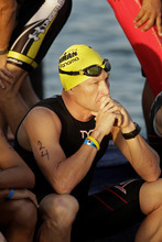 FILE - In this Feb. 12, 2012, file photo, Lance Armstrong waits for the start of the Ironman Panama 70.3. triathlon in Panama City, Panama. The U.S. Anti-Doping Agency is bringing doping charges against the seven-time Tour de France winner, questioning how he achieved those famous cycling victories.  Armstrong, who retired from cycling last year, could face a lifetime ban from the sport if he is found to have used performance-enhancing drugs. He maintained his innocence, saying:
