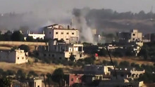 In this image made from amateur video released by Shaam News Network and accessed Monday, June 11, 2012, purports to show smoke leaping the air from Syrian government forces shelling in Rastan town in Homs province, Syria. Syrian troops attacked a central, rebel-held town with helicopter gunships Monday and shelled other restive areas across the nation, activists said. The aerial assault targeted the strategic river crossing town of Rastan, which has resisted repeated government offensives for months, the activists said. (AP Photo/Shaam News Network via AP video) TV OUT, THE ASSOCIATED PRESS CANNOT INDEPENDENTLY VERIFY THE CONTENT, DATE, LOCATION OR AUTHENTICITY OF THIS MATERIAL