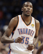 Oklahoma City Thunder small forward Kevin Durant (35) looks at the scoreboard against the Miami Heat during the first half at Game 1 of the NBA finals basketball series, Tuesday, June 12, 2012, in Oklahoma City. (AP Photo/Jeff Roberson)