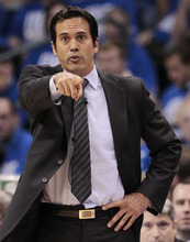 Miami Heat head coach Erik Spoelstra directs play from sideline against the Oklahoma City Thunder during the first half at Game 1 of the NBA finals basketball series, Tuesday, June 12, 2012, in Oklahoma City. (AP Photo/Jeff Roberson)