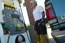 Chris Detrick  |  The Salt Lake Tribune Garry Pennington, of Kamas, fills up his vehicle with gas at Holiday gas station on 12600 South 1300 West in Riverton, Utah Wednesday June 13, 2012.