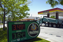 Chris Detrick  |  The Salt Lake Tribune Cars and trucks fill up at Holiday gas station on 12600 South 1300 West in Riverton, Utah Wednesday June 13, 2012.