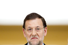 Spain's Prime Minister Mariano Rajoy reacts during a press conference at the Moncloa Palace, in Madrid, Sunday, June 10, 2012. Spain became the fourth and largest country to ask Europe to rescue its failing banks, a bailout of up to 100 billion euros ($125 billion) that leaders hoped would stabilize a financial crisis that threatens to break apart the 17-country eurozone. (AP Photo/Daniel Ochoa de Olza)