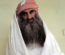 FILE - This undated photo downloaded from the Arabic language Internet site www.muslm.net and purporting to show a man identified by the Internet site as Khalid Sheik Mohammed, the accused mastermind of the Sep. 11 attacks, is seen in detention at Guantanamo Bay, Cuba. A new book says Justice Department prosecutors were stunned to learn three years ago that the U.S. military had secretly tape recorded incriminating comments that alleged 9/11 mastermind Khalid Sheikh Mohammed made to fellow detainees during daily prison yard conversations but was not planning to use them at military tribunals. . (AP Photo/www.muslm.net)
