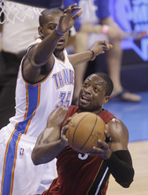 Miami Heat shooting guard Dwyane Wade (3) shoots as Oklahoma City Thunder small forward Kevin Durant (35) defends during the first half at Game 1 of the NBA finals basketball series, Tuesday, June 12, 2012, in Oklahoma City. (AP Photo/Sue Ogrocki)