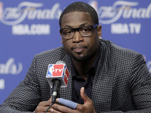 Miami Heat shooting guard Dwyane Wade participates in a news conference after Game 1 of the NBA finals basketball series against the Oklahoma City Thunder, Tuesday, June 12, 2012, in Oklahoma City. The Thunder won 105-94. (AP Photo/Sue Ogrocki)