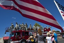 Chris Detrick     The Salt Lake Tribune Members of the Utah Army National Guard 624th Engineer Company wave to a crowd of supporters during a parade along 100 North in Price Tuesday June 12, 2012. Around sixty soldiers from Utah will be deployed for a year to Afghanistan.