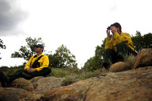 Pam Pickle, right, and Todd Westfall, of the Glacier Fire Department, spot fires as the High Park fire burns in Poudre Canyon, west of Fort Collins, Colo. on Tuesday, June 12, 2012. The fire has now burned more than 40,000 acres encompassing more than 65 square miles. (AP Photo/The Denver Post, Aaron Ontiveroz)  MAGS OUT; TV OUT; INTERNET OUT