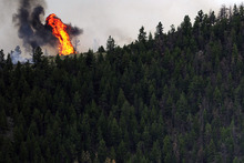The High Park fire burns in Poudre Canyon, as seen from Glacier View Meadows, west of Fort Collins, Colo. on Tuesday, June 12, 2012. The fire has now burned more than 40,000 acres encompassing more than 65 square miles. (AP Photo/The Denver Post, Aaron Ontiveroz)  MAGS OUT; TV OUT; INTERNET OUT