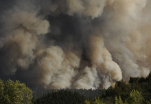 In this Saturday, June 9, 2012 photo, thick smoke rises from the burning fire south of the Cache La Poudre River at the intersection of Larimer County Road 27 and Colorado Highway 14, west of Fort Collins, Colo. (AP Photo/The Denver Post, Karl Gehring)  MAGS OUT; TV OUT; INTERNET OUT