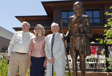 Al Hartmann  |  The Salt Lake Tribune  Sculptor Dennis Smith, left, Anne Burkholder, YWCA's chief executive officer, and Boyer Jarvis, board member of the Ghandi Alliance for Peace, pose for unveiling of the new sculpture of Mahatma Gandhi in front of the the YWCA's new Center for Families.