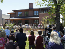 Al Hartmann  |  The Salt Lake Tribune  People gather in the shade as the YWCA dedicates its new Center for Families, which will house an expanded Salt Lake Area Family Justice Center and the YWCA's Community Education Program at 310 E. 300 South in Salt Lake City.