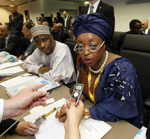 Nigeria's Minister of Petroleum Resources Diezani Alison-Madueke, right, speaks to journalists prior to the start of the meeting of the Organization of the Petroleum Exporting Countries, OPEC, at their headquarters in Vienna, Austria, on Thursday, June 14, 2012. The meeting of the 12 oil ministers of the OPEC focuses on price and production targets. (AP Photo/Ronald Zak)