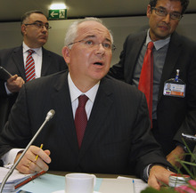 Venezuela's Minister of Energy and Petroleum Rafael D Ramirez speaks to journalists prior to the start of the meeting of the Organization of the Petroleum Exporting Countries, OPEC, at their headquarters in Vienna, Austria, on Thursday, June 14, 2012. (AP Photo/Ronald Zak)