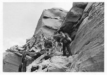 Everett Ruess, right, and his burro make their way up an Escalante path with the help of an unidentified friend. This archival photo is used in
