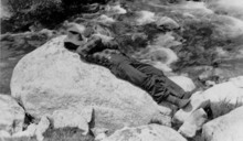 Everett Ruess takes a rest near a river stream in this archival photo is used in