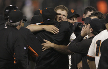 San Francisco Giants pitcher Matt Cain, facing, celebrates with teammates after pitching a perfect game in a baseball game against the Houston Astros in San Francisco, Wednesday, June 13, 2012. The Giants won 10-0. (AP Photo/Jeff Chiu)