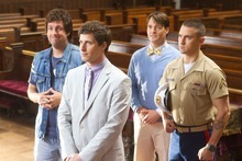 This film image released by Columbia Pictures shows, from left, Adam Sandler, Andy Samberg, Will Forte and Milo Ventimiglia in a scene from