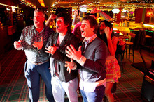 This film image released by Columbia Pictures shows, from left, Rex Ryan, Adam Sandler, Andy Samberg and Ciara in a scene from