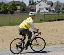 Al Hartmann     The Salt Lake Tribune  Salt Lake City Mayor Ralph Becker rides his bike on the newly  completed section of the Jordan River Parkway Trail at 1800 North Redwood Road on Thursday.