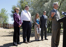 Al Hartmann     The Salt Lake Tribune  Mayor Ralph Becker, right, speaks at celebration of the completion of one the last sections of the Jordan River Parkway Trail at 1800 N. Redwood Road on Thursday June 7, 2012. Davis County Commissioner Louenda Downs, left back row,  Salt Lake City Councilman Carlton Christensen, Jordan River Commission Executive Director Laura Hanson, and Wasatch Front Regional Council Executive Director Andrew Gruber aslo spoke.   The new section of Jordan River Parkway trail extends one mile from Redwood Road at approximately 1800 North, to the Davis County line and includes a 10-foot-wide asphalt trail, 5-foot- wide horse trail and 1,000 feet of elevated boardwalk through a wetlands area.