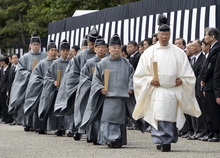 Shinto priests walk during a funeral for the late Prince Tomohito, a cousin of Emperor Akihito, at Toshimagaoka imperial cemetery in Tokyo Thursday, June 14, 2012. (AP Photo/Toshifumi Kitamura, Pool)