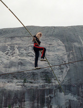 FILE- In this Sept. 21, 1991 file photo, aerialist Angel Wallenda walks the high-wire performs at Stone Mountain, Ga. Wallenda, who lost a leg to cancer but trained herself to walk the wire with the help of a prosthetic leg, eventually died of the disease on May 3, 1996, at age 28. On Friday, June 15, 2012, Nik Wallenda, a seventh generation