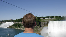 Nik Wallenda looks at the tightrope cable in Niagara Falls, Canada, Wednesday, June 13, 2012. On Friday night Wallenda's attempt at being the first person to walk across the falls on a tightrope will be broadcast on a live ABC special, with CTV carrying it in Canada. (AP Photo/David Duprey)