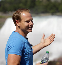 Nik Wallenda speaks to the media in Niagara Falls, Canada, Wednesday, June 13, 2012. On Friday night Wallenda's attempt at being the first person to walk across the falls on a tightrope will be broadcast on a live ABC special, with CTV carrying it in Canada. The American broadcaster is partly funding Wallenda's walk, but also requested he wear a tether in case something goes wrong. (AP Photo/David Duprey)