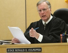 Rick Egan  | The Salt Lake Tribune   Judge Ronald E. Culpepper discusses an issue with the attorneys on the third day of Steve Powell's trial for voyeurism charges in the Pierce County Superior Court in Tacoma, Wash., Wednesday, May 9, 2012.