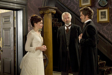 Dr. Mortimer Granville (Hugh Dancy, right) is introduced by his new boss, Dr. Robert Dalrymple (Jonathan Pryce, center), to Dr. Dalrymple's prim daughter Emily (Felicity Jones), in the Victorian comedy