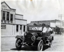 Tribune file photo  A group of men ride in one of the first cars to be owned in Tremonton, Utah. The upper floor of the lumber company behind them was a dancehall that opened on Christmas Eve, 1903.