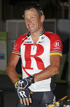 In this Jan. 24, 2011, file photo American cyclist Lance Armstrong prepares for a fundraising ride through the streets of Brisbane, Australia. Federal prosecutors said, Friday, Feb. 3, 2012, they are closing a criminal investigation of Armstrong and will not charge him over allegations the seven-time Tour de France winner used performance-enhancing drugs. (AP Photo/Tertius Pickard, File)