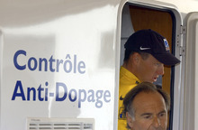 FILE - In this July 24, 2022, file photo, cyclist Lance Armstrong of Austin, Texas, walks out of  the Tour de France's anti-doping control bus after the 16th stage of the Tour de France cycling race between Les Deux Alpes and La Plagne, French Alps. The U.S. Anti-Doping Agency is bringing doping charges against the seven-time Tour de France winner, questioning how he achieved those famous cycling victories.  Armstrong, who retired from cycling last year, could face a lifetime ban from the sport if he is found to have used performance-enhancing drugs. He maintained his innocence, saying: