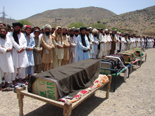 FILE - In this Thursday, June 16, 2011, file photo, Pakistani villagers offer funeral prayers for people who were reportedly killed by a U.S. drone attack in Miranshah, capital of Pakistani tribal region of North Waziristan  along the Afghanistan border. The Obama administration's increasing use of unmanned drone strikes to kill terror suspects is widely opposed around the world, according to a Pew Research Center survey on the U.S. image abroad.  (AP Photo/Hasbunullah, File)