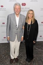 Former President Bill Clinton poses with Barbra Streisand at the dedication of the Barbra Streisand Women's Heart Center in the Cedars-Sinai Heart Institute, on Thursday June 14, 2012  at Streisand's home in Malibu, Calif. (Photo by Chris Pizzello/Invision/AP)