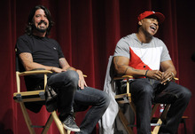 Musicians Dave Grohl, left, and LL Cool J take part in a panel discussion following the premiere of the documentary film