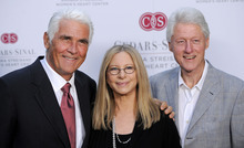 Former President Bill Clinton, right, poses with Barbra Streisand, center, and her husband James Brolin at the dedication of the Barbra Streisand Women's Heart Center in the Cedars-Sinai Heart Institute, on Thursday June 14, 2012 at Streisand's home in Malibu, Calif. (Photo by Chris Pizzello/Invision/AP)
