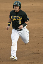 Chris Detrick  |  The Salt Lake Tribune Salt Lake Bees Kole Calhoun scores a RBI during the game against Fresno Grizzlies at Spring Mobile Ballpark Friday June 15, 2012.