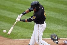 Chris Detrick  |  The Salt Lake Tribune Salt Lake Bees Efren Navarro hits an RBI during the game against Fresno Grizzlies at Spring Mobile Ballpark Friday June 15, 2012.