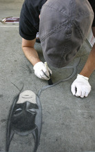 Rick Egan  | The Salt Lake Tribune   Alex Getts draws Batman, at the Utah Foster Care Foundation's Annual Chalk Art Festival, at the Gateway in Salt Lake City, Friday, June 15, 2012.  The festival continues through Saturday.