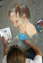 Rick Egan  | The Salt Lake Tribune   Mary E. Jensen draws a picture of her niece, at the Utah Foster Care Foundation's Annual Chalk Art Festival, at the Gateway in Salt Lake City, Friday, June 15, 2012.  The festival continues through Saturday.