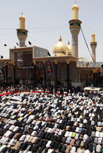Shiite pilgrims pray at the Imam Moussa al-Kadhim shrine during the annual commemoration of the saint's death in the Shiite district of Kazimiyah, in Baghdad, Iraq, Friday, June 15, 2012. (AP Photo/Karim Kadim)