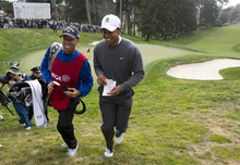 Tiger Woods and Phil Mickelson's caddie, Jim Mackay, leave the 18th hole during the first round of the U.S. Open golf tournament, Thursday, June 14, 2012, at Olympic Club in San Francisco. (AP Photo/The Sacramento Bee, Paul Kitagaki Jr.) TV OUT  MAGS OUT  MANDATORY CREDIT