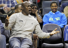 FILE - In this March 9, 2012, file photo, Charlotte Bobcats owner Michael Jordan gestures at the referees during the first half of an NBA basketball game against the New Jersey Nets in Charlotte, N.C. The Bobcats, after the worst season in NBA history, fell to the No. 2 pick in the draft lottery, Wednesday, May 30, in New York. (AP Photo/Bob Leverone, File)
