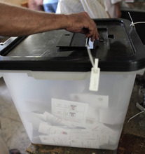 An Egyptian man casts his vote during the first day of the presidential runoff, in Cairo, Egypt Saturday, June 16, 2012. Egyptians voted Saturday in the country's landmark presidential runoff, choosing between Hosni Mubarak's ex-prime minister and an Islamist candidate from the Muslim Brotherhood after a race that has deeply polarized the nation. The two-day balloting will produce Egypt's first president since a popular uprising last year ousted Mubarak, who is now serving a life sentence. (AP Photo/Nasser Nasser)