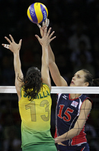 Utah native and Highland High grad Logan Tom (15) battles against Brazil during their women's volleyball final at the Beijing 2008 Olympics. Tom is gearing up for her fourth Olympics next month in London. (AP Photo/Andy Wong)